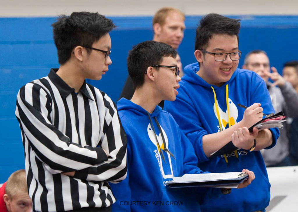 VEX robotics alumni pay back as judges and refs